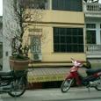 バイクで正月の花を運ぶのです